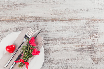 Rustic table setting with thyme and cyclamen flowers