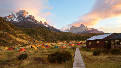 Colorful tent camping early morning with sunrise in Torres del Paine National Park, Patagonia mountains, Chile