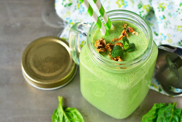 Detox drink - Green smoothie with spinach, mint, yogurt and granola for breakfast. Metallic background. Organic food.