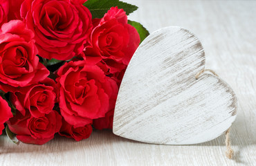 Heart and a bouquet of red roses on wooden board, Valentines Day background