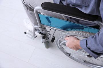 Man in wheelchair indoors