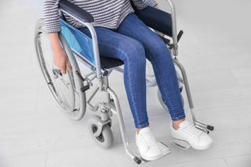 Woman in wheelchair indoors