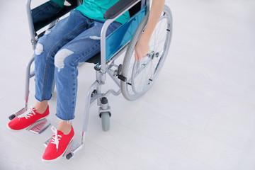Girl in wheelchair indoors