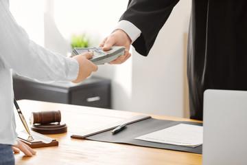 Judge taking bribe from woman, closeup