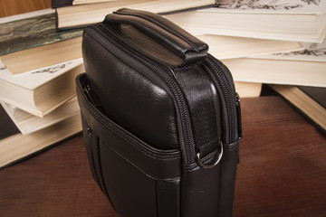 men's black bag; leather texture of a handbag close-up
