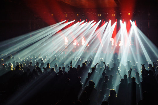Crowd raising their hands and enjoying great festival party or concert
