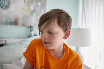 Boy Waking up in Bedroom