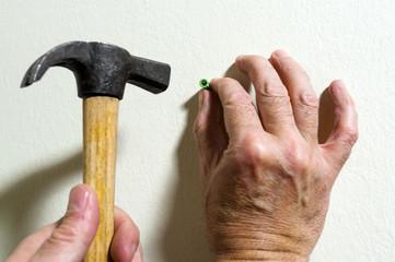 electrician  placing rawlplug with hammer