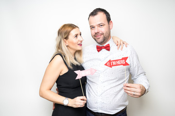 young couple posing party props white background camera wedding