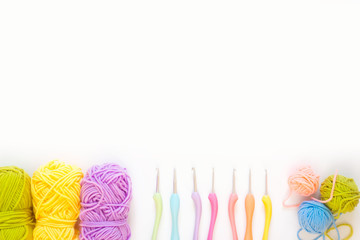 Crochet hooks and yarn color. White background.