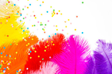Poster Carnaval Bright colored feathers for a carnival costume. Color confetti. White background.