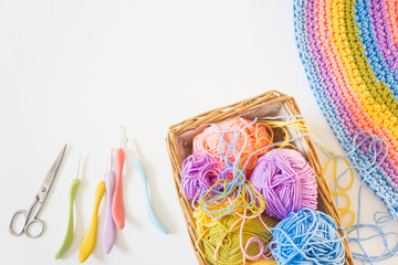 Colorful round yarn mat. Crochet. Yarn in coils and tangles. White background.