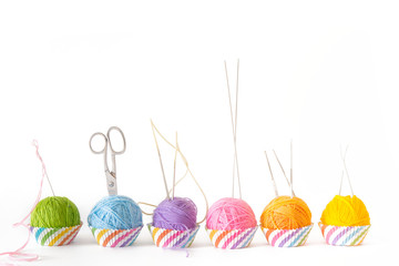 Colored yarn in the form of capkeys or mafins. Colors of rainbow. Isolate. White background.