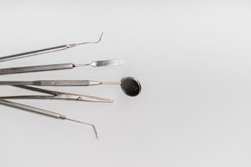 on a white background is a dental instrument