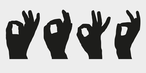 Set of silhouettes of hands showing symbol OK, All right or Very good. Vector illustration.