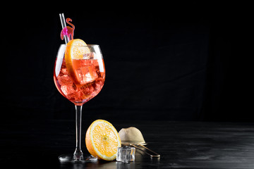orange spritzer cocktail fancy clean beverage alcohol drink lime mixed bartender black background bottle