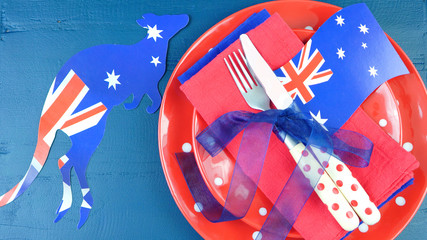 Happy Australia Day bbq or party table setting in red, white and blue theme.