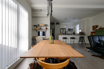 Luxury dining room, small office and modern white kitchen. Interior design.