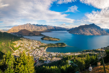 Queenstown Panorama at golden hour, New Zealand, South Island. View from Queenstown Skyline, main attraction in the alpine city.