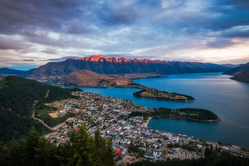 Red light on the Remarkables mountain in Queenstown at sunset.  View from Queenstown Skyline, New Zealand, South Island.