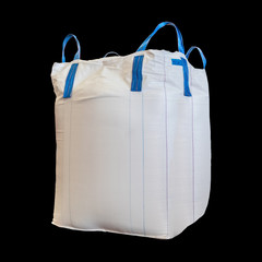 Jumbo bag of white sugar isolated on black background with clipping path.