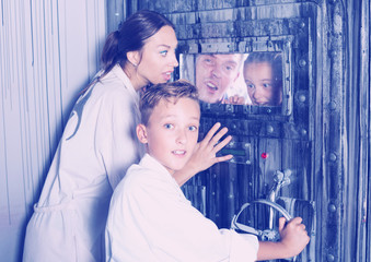 Family is helping dad and girl get out of the locked door