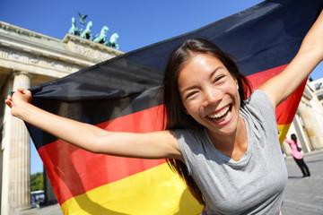 Happy Woman With German Flag By Brandenburg Gate B
