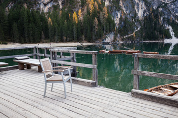 Wooden chair on the Alpine mountain lake