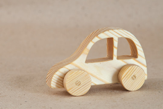 Wooden toy (car) handmade with a pronounced wood structure