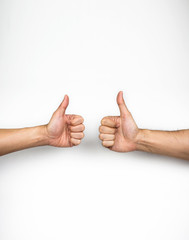 Two thumbs up on white background