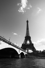 black and white view of the Eiffel Tower from the Seine