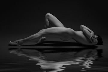 nude woman on a dark background