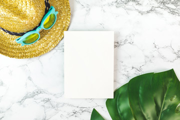 Wall Mural - Blank white paper card on marble table top view with summer beach accessories monstera leaves ,Summer vacation concept,Mock up template for adding your design or text
