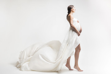 Young pregnant woman in studio