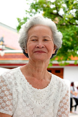 Older Asian women with grayish hair have smiling faces