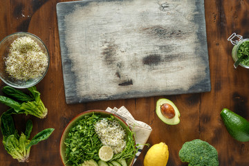 Cutting board set ingredients cooking detox salad. Healthy food concept