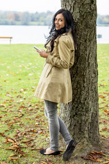 woman listens to music on the mobile phone