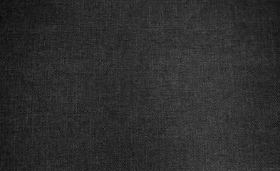 Dunkler grauer Stoff als Hintergrund
