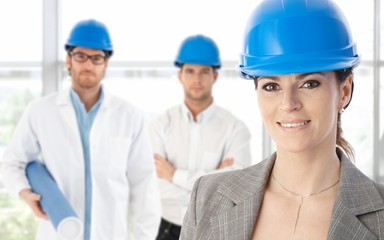 Engineers in hardhat woman in front