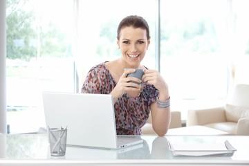 Happy casual businesswoman on coffee break