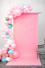 Pink background decorated blue balloons studio