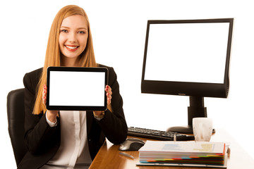 Beautiful young business woman surf internet on tablet in office