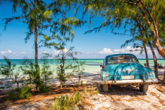 Classic car on a beach in Cuba