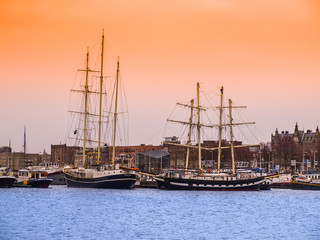 Old wooden ships in Amsterdam harbour, Netherlands.