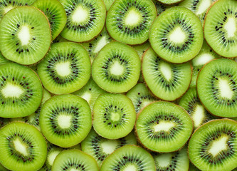 Printed kitchen splashbacks Macro photography a lot of kiwi slices as textured background