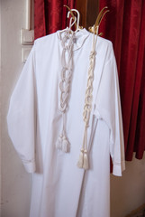 white clothes of christian priest on a hanger