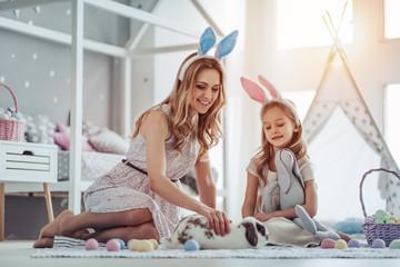 Mom and daughter preparing for Easter celebration
