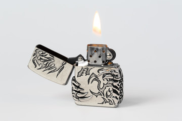 gasoline lighter with flame