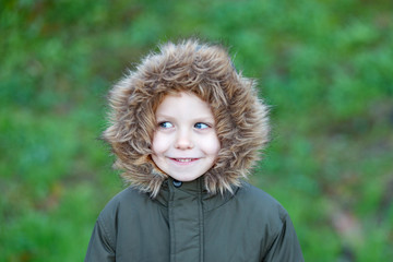Small child in the park with a warm coat