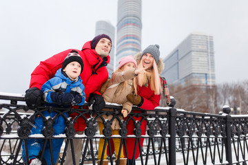 Picture of parents with daughter and son on winter walk
